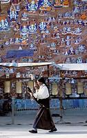 BUDDHIST PILGRIM, CHAGPO RI HILL, LHASA, TIBET.