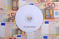 CD labelled Kundendaten, German for customer data, 50 euro notes, symbolic image for illegal trade with customer data, breach of data protection, data...