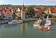 This stock photo shows the famous historical old town of the Bavarian city of Lindau, in Germany, with the harbour in the foreground. In front of the ...