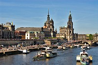 This image shows the famous annual steam ship parade on the Elbe River near the old town of Dresden in Germany.