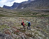 Two backpackers hiking to Ptarmigan Pass, Chugach State Park, Southcentral Alaska, Summer