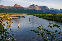 Anglers fly fishing in Bristol Bay in the evening near Crystal Creek Lodge with a floatplane moored in the background, King Salmon, Southwest Alaska, ...