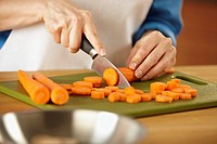 Woman chopping carrots