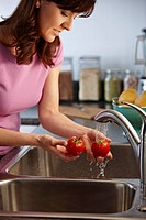 Woman washing tomatoes