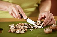 Woman slicing mushrooms