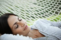 Woman relaxing in hammock (thumbnail)