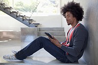 Young man using an e_reader