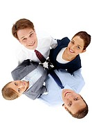 Above view of several happy business partners looking at camera while embracing each other