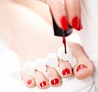 Close_up of female feet with red polished nails