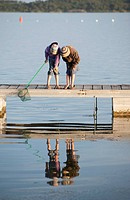 Two girls 10_11 fishing on Jetty, Aleria, Corsica