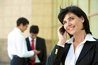 Portrait of pretty boss talking by mobile phone with smile