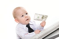 Portrait of serious baby boy giving hundred_dollar banknote to someone