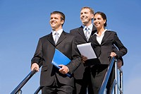 Team of business people on the background of blue sky