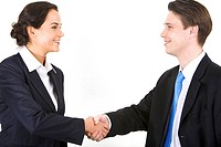 Photo of partners handshaking after signing contract
