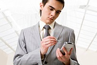 Image of successful employer working on mobile personal gadget