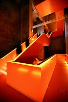 Red illuminated main staircase in the new Ruhrmuseum museum, opened in January 2010, Capital of Culture year, in the former coal washing plant of the ...