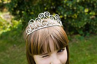Girl wearing tiara and winking