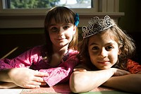 Two girls, one wearing tiara
