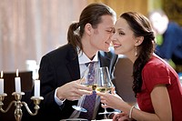 Image of amorous couple toasting in restaurant during romantic dinner