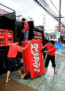 Men transporting a Coca-Cola fridge, Thailand, Asia