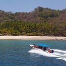 Costa Rica, Puntarenas Region, Near Cobano, Pacific coast, Beach, Boat                                                                                ...