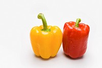 Image of red and yellow peppers isolated over white background