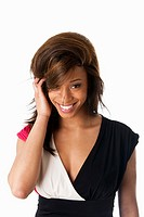 Face of beautiful African American business woman with a smile and shy expression and hand in straight hair, isolated