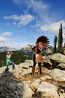 Child photographing a Native American iron chief, Mt. Revelstoke, Meadows in the Sky, Revelstoke National Park, British Columbia, Canada
