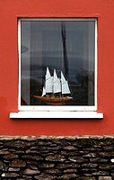 Model sailing boat in window, Ireland, Europe