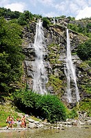 People bathing in the waterfalls of Fraggia Acquaviva, Borgo Nuovo village, Piuro, Val Bregaglia, Bergell Valley and Chiavenna, province of Sondrio, I...
