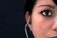 Female Doctor with Stethoscope in the Ear