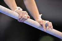 Detail, gymnast on uneven bars