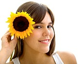 Beautiful woman with a sunflower on her head isolated