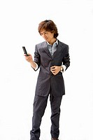 Young Asian business man with mobile phone texting, isolated