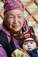 Kyrgyz grandmother and kid in a yurt  Near Irkestan pass  Kyrgyzstan