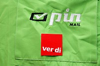 Verdi sticker on a PinMail uniform jacket, private mail delivery service
