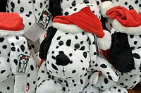 Stuffed dalmatians wearing Santa hats for sale at Sheikh Rashid Terminal, Dubai International Airport, Dubai, United Arab Emirates, Asia
