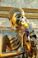 Golden Buddha statue with stick and umbrella (symbol of luck and power), Wat Phra That Doi Suthep Temple, Chiang Mai, Thailand, Southeast Asia