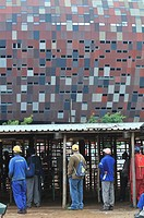 2010 FIFA World Cup, young men are looking for work at the construction site of the Soccer City Stadium, Soweto district, Johannesburg, South Africa, ...