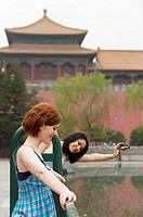 Tourists, one taking photos of the other, The Forbidden City, Beijing, China, Asia  MR