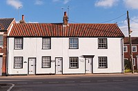 A row of pretty cottages in Southwold , Suffolk , England , Britain , Uk
