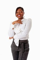 Beautiful African American business woman with attitude dressed in a white shirt and gray pants standing, laughing, isolated
