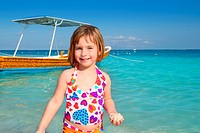 blond little girl in Caribbean beach vacation