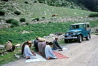 Pakistan, Upper Swat valley, Mahodand lake road, Muslim devouts in prayer.