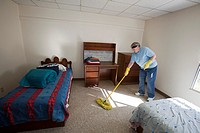 Española, New Mexico - Becky Walker cleans a dormitory room at McCurdy School, a private school supported by the United Methodist Church  She was part...