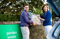 A mid_adult couple recycling garden waste