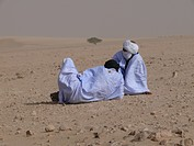 bedouins resting while a sandstorm in the mauritanian desert
