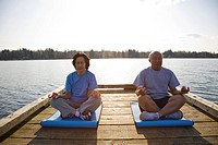 A shot of senior asian couple exercising and practicing yoga