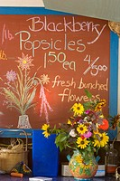 Sign inside roadside produce stand, Humboldt County, California