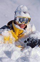Male skier covered with snow smiling